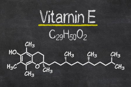 Blackboard with the chemical formula of Vitamin E Stock Photo