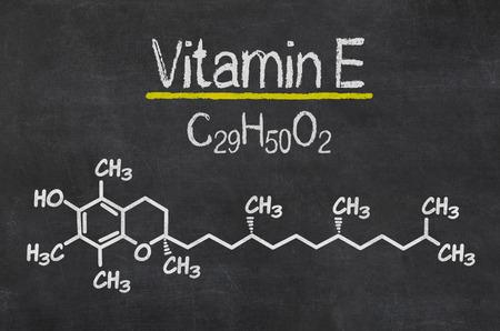 vitamin: Blackboard with the chemical formula of Vitamin E Stock Photo