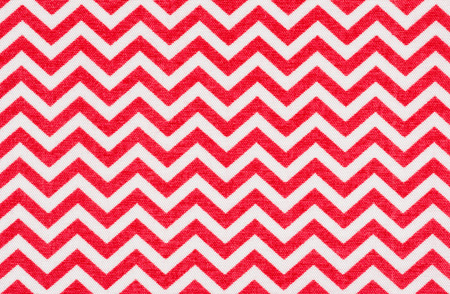 White fabric with a red chevron pattern photo