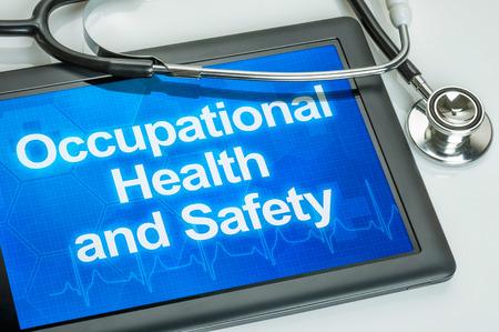 seguridad e higiene: Tablet con el texto de la Salud y Seguridad en el Trabajo