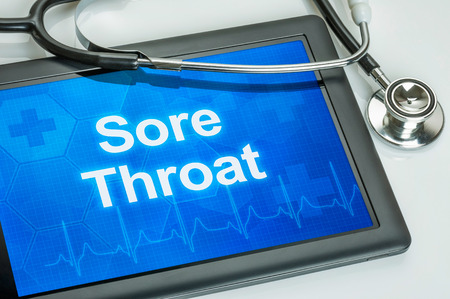 pharyngitis: Tablet with the text Sore Throat on the display
