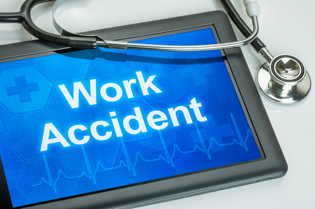 personal injury: Tablet with the text Work accident on the display Stock Photo