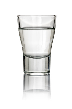 Filled Shot Glass on a white background photo