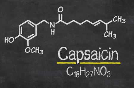 capsaicin: Blackboard with the chemical formula of Capsaicin