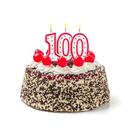 100 番のキャンドルを燃焼と誕生日ケーキ 写真素材