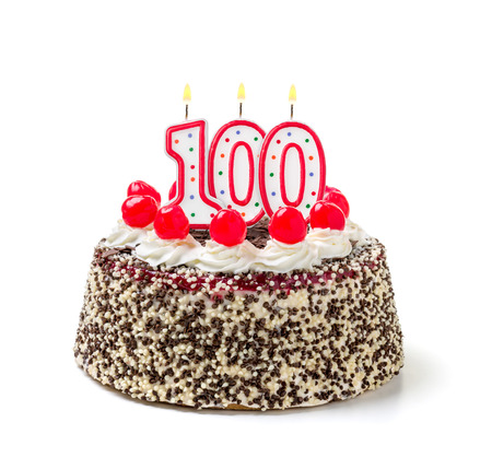 Birthday cake with burning candle number 100