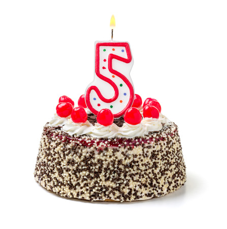 5th: Birthday cake with burning candle number 5 Stock Photo