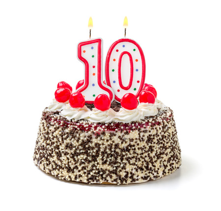 10 years: Birthday cake with burning candle number 10