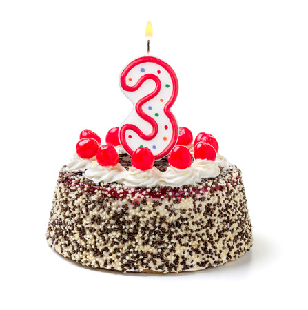 third age: Birthday cake with burning candle number 3 Stock Photo