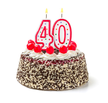 age forty: Birthday cake with burning candle number 40