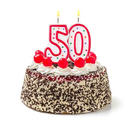 Verjaardagstaart met brandende kaars nummer 50