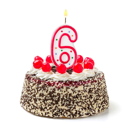 six months: Birthday cake with burning candle number 6 Stock Photo
