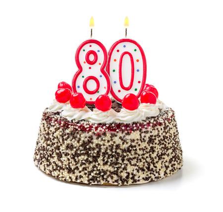 meses del a  ±o: Torta de cumpleaños con vela encendida número 80 Foto de archivo