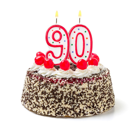 90: Birthday cake with burning candle number 90 Stock Photo