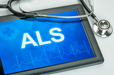 Tablet with the text ALS on the display Stock Photo