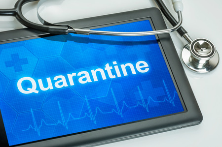quarantine: Tablet with the text Quarantine on the display