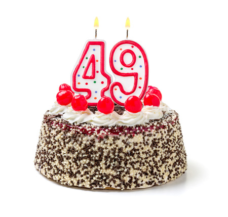Birthday cake with burning candle number 49
