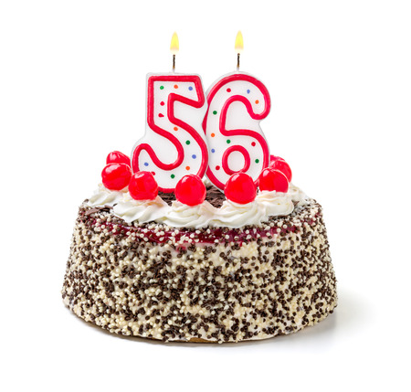 six months: Birthday cake with burning candle number 56