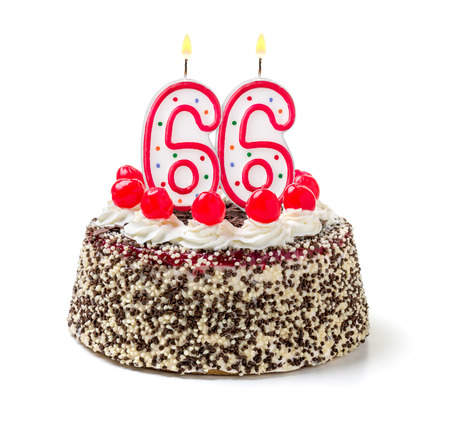 six months: Birthday cake with burning candle number 66