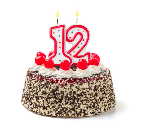 number 12: Birthday cake with burning candle number 12