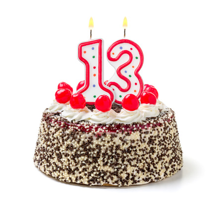 meses del a  ±o: Torta de cumpleaños con vela encendida número 13 Foto de archivo