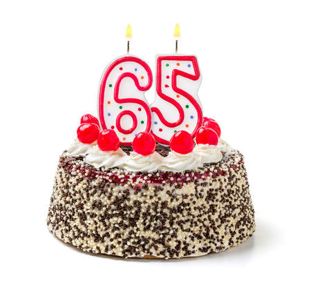 Birthday cake with burning candle number 65 Imagens - 32590290