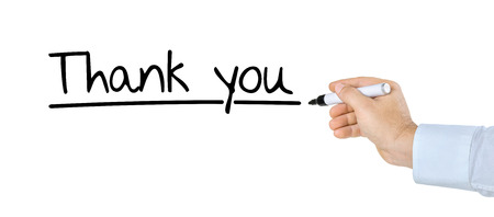 Hand with pen writing Thank you photo