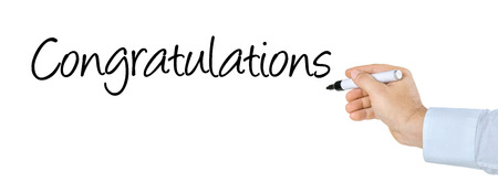 congratulations word: Hand with pen writing the word Congratulations