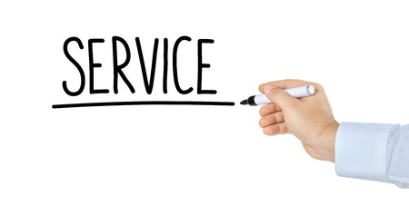 advise: Hand with pen writing the word Service