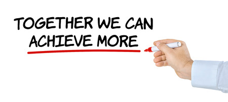 achieve: Hand with pen writing Together we can achieve more