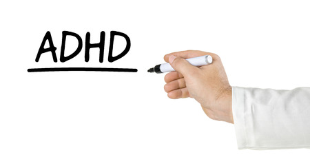 adhd: Hand with pen writing ADHD