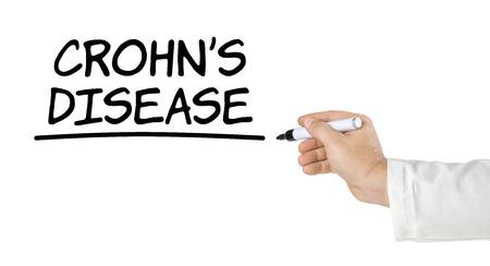 Hand with pen writing Crohn's Disease Stok Fotoğraf