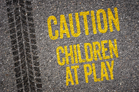 road mark: Lane with the text Caution Children at play