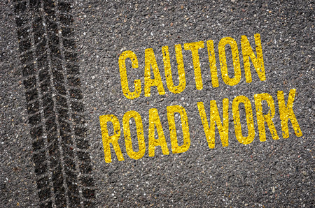 roadwork: Lane with the text Caution Road work