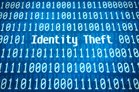 Binary code with the word Identity Theft in the center photo