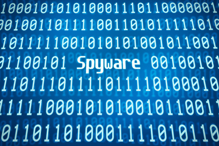 online privacy: Binary code with the word Spyware in the center