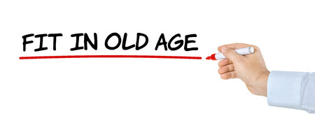 older people: Hand with pen writing Fit in old age Stock Photo
