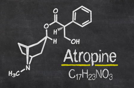 acetylcholine: Blackboard with the chemical formula of Atropine Stock Photo