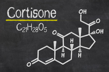 hormone: Blackboard with the chemical formula of Cortisone Stock Photo
