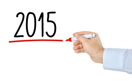 Hand with pen writing 2015 Stock Photo