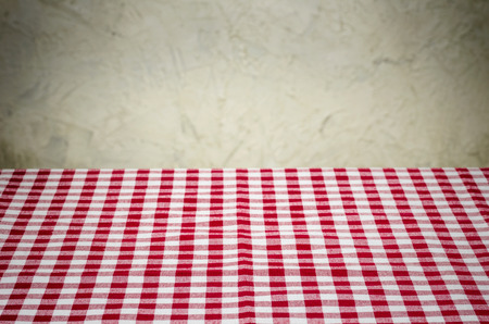 country kitchen: Background with checkered tablecloth and a rustic wall Stock Photo