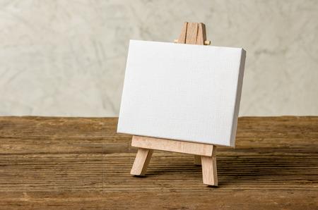 blank canvas: Easel with a blank canvas