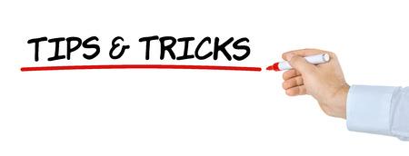 Mano con pluma de escribir Consejos y trucos Foto de archivo
