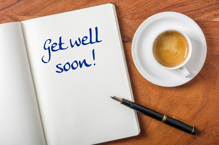 ink well: Notebook on a desk - Get well soon