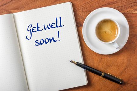 Notebook on a desk - Get well soon