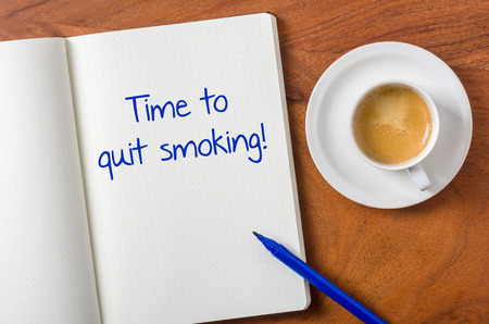 quit smoking: Notebook on a desk - Time to quit smoking