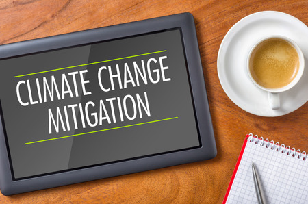 mitigation: Tablet on a desk - Climate Change Mitigation