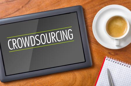 crowd sourcing: Tablet on a desk - Crowdsourcing