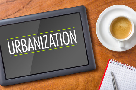urbanization: Tablet on a desk - Urbanization Stock Photo