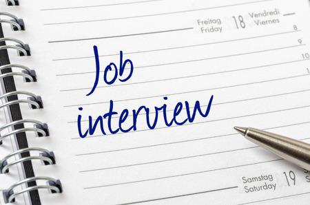 entrevista de trabajo: Entrevista de trabajo escrito en una p�gina de calendario
